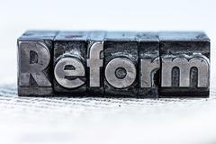 written reform in lead letters - stock photo