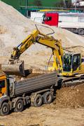Excavator at construction site during excavation Stock Photos