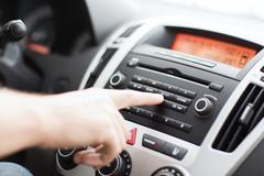 Man using car audio stereo system Stock Photos