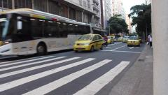 Brazil Traffic Scene - Buses and Cabs Pass in Copacabana, Rio de Janeiro Stock Footage