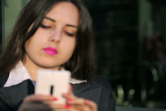 Blurred businesswoman texting on cellphone and view of cafe interior Stock Footage