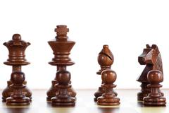photography of black pieces chess on chessboard - stock photo