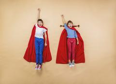 children as superheroes - stock photo