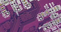 Purple Magenta Circuit Board Closeup Computer Motherboard Internet Networking Stock Footage
