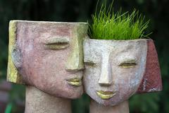 The flower pot in the form of the feminine head Stock Photos