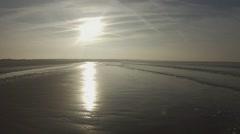 Winter sun on an empty Dutch beach Stock Footage