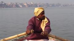 Boatman Rowing Boat on the Ganges River, Varanasi, Uttar Pradesh, India - stock footage