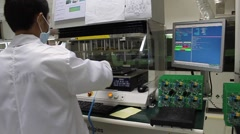 Male Factory Worker Testing Technology in Vietnam Stock Footage