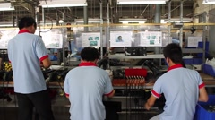 Factory Workers on Vietnam Assembly Line Stock Footage