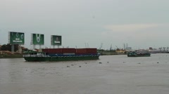 Container Barges Move Down River in Ho Chi Minh City, Vietnam Stock Footage
