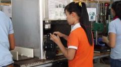 Female Vietnamese Factory Worker Operating Machine Stock Footage