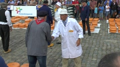 Hand slapping negotiation (with audio) in the cheese market, Gouda, Netherlands. Stock Footage