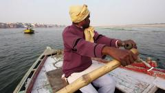 Boatman Rowing Boat on the Ganges River, Varanasi, Uttar Pradesh, India Stock Footage