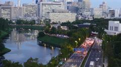 Traffic evening to night in Tokyo TL tilt 4K Stock Footage