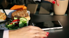 Businesswoman typing message on smartphone outside the cafe Stock Footage