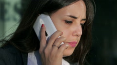 Upset businesswoman talking on cellphone and receiving bad news Stock Footage