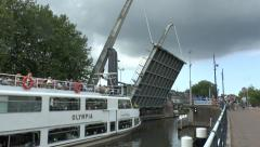 Boat going under a raised bascule bridge, Delft, South Holland, Netherlands. Stock Footage