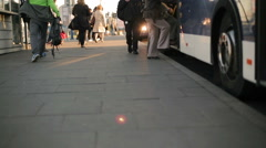 People waiting for the bus and embus on the station Stock Footage