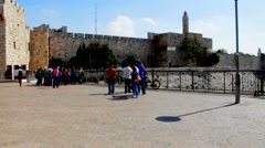 Visitors near the Jaffa Gate and David tower  of ancient Jerusalem Stock Footage