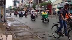 Two-Wheeled Commuters in Ho Chi Minh City - stock footage