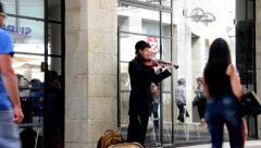 Street violinist on Mamilla Street in West Jerusalem Stock Footage