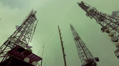 4K Communication towers site extreme weather fog mist Stock Footage