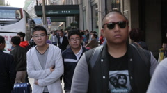Chinese youth on the streets of Shanghai Stock Footage