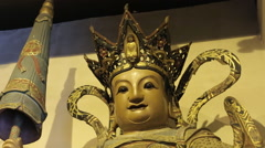 Head of the statue at the Buddhist temple Stock Footage