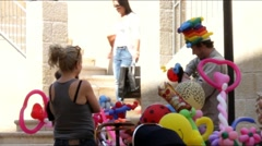 Street vendor rubber toys on the  Mamilla street in West Jerusalem 7 Stock Footage