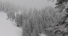 Spectacular Establishing Shot People Walking Frozen Forest Winter Snowy Mountain Stock Footage