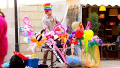 Street vendor rubber toys on the  Mamilla street in West Jerusalem 4 Stock Footage