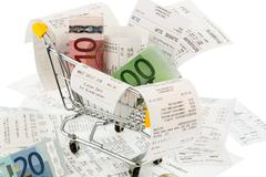 shopping cart, receipts and money - stock photo