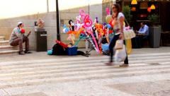 Street vendor rubber toys on the  Mamilla street in West Jerusalem 1 Stock Footage