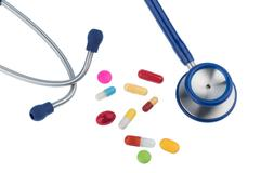 colorful tablets a stethoscope - stock photo