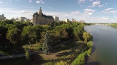 Stock Video Footage of A scenic aerial shot of the downtown Saskatoon riverbank