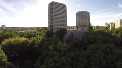 A scenic aerial shot of the downtown Saskatoon riverbank Stock Footage