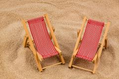 deck chair on the sandy beach - stock photo