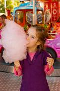 Child on kirtag with cotton candy Stock Photos