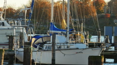 2602 Sailboat at Dock During Sunset with Wind Turbine in Background, HD Stock Footage