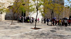 Group of  tourists go on an excursion from the Jaffa Gate. Jerusalem Stock Footage