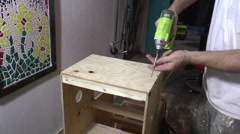 Screwing Wood with Impact Driver Stock Footage