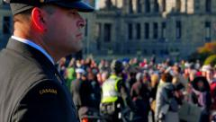 4K Close up Canadian Soldier Standing Guard and Crowd, Government Buildings Stock Footage