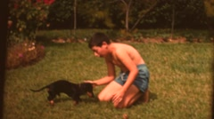 Vintage home movies,  brothers and dog Stock Footage