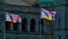 4K Provincial Flags of British Columbia in Front of Legislature Buildings - stock footage