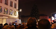 Counting down for illuminating Christmas tree Stock Footage
