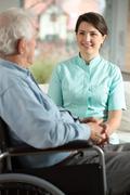 nurse visiting disabled patient - stock photo