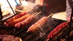 Street Vendor Cooking Hot Dogs/Sausages Stock Footage