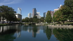 Charlotte skyline reflected in water, nc, usa Stock Footage