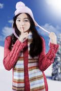 cute girl warn to quiet - stock photo