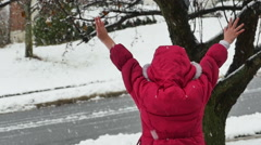 2644 Child With Arms Open Wide As Snowflakes Fall in Slow Motion Stock Footage